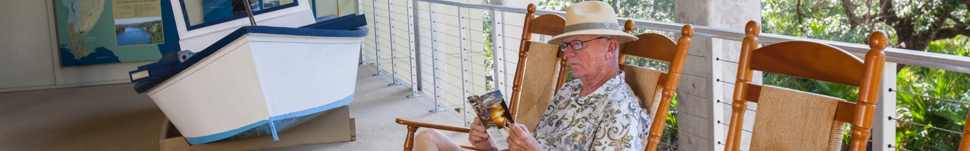Man reading book on the porch